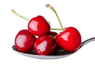 Fresh red cherries on a spoon