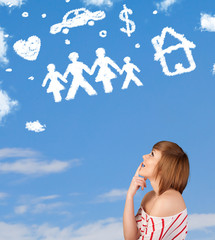 Young girl daydreaming with family and household clouds