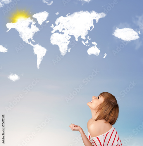 canvas print picture Young girl looking at world clouds and sun on blue sky
