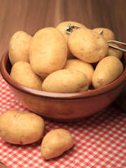 Potatoes and peeler