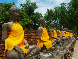 Aligned buddha statues in Phra Chedi Chaimongkol, Ayutthaya