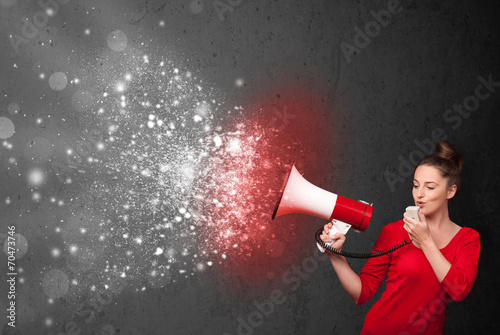 canvas print picture Woman shouting into megaphone and glowing energy particles explo