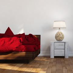 Bett neben Nachttisch mit Lampe
