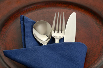 silverware in blue napkin