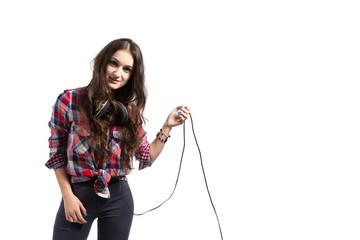A beautiful girl posing with headphones.
