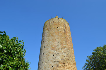 Tall ancient tower in medieval village of Pals