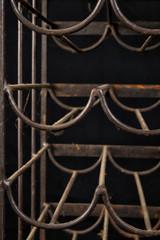 Rusty iron wine-rack