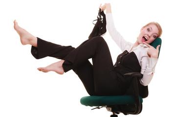 Break from work. Businesswoman relaxing on chair.