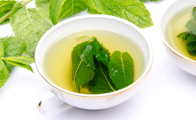 Cup of mint tea with fresh mint