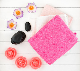 Spa and bath accessories with candles, towel and sea salt