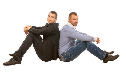Two Men Sitting Back to Back in Studio