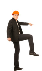 Young Male Engineer Lifting One Leg Posing