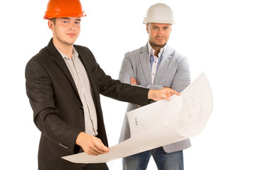 Two architects studying a building blueprint