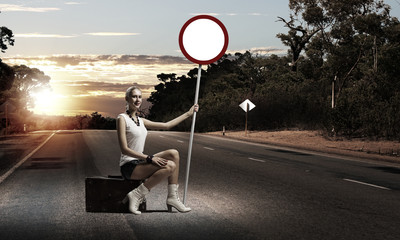 Girl with roadsign