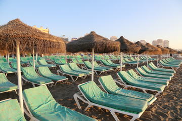 Beach lounge chair and beach umbrella. Costa del Sol, Spain
