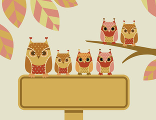 Owls with a sign
