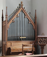 A Traditional Church Organ Set in a Wooden Frame.