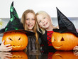 canvas print picture - Cute girls with pumpkins in the kitchen