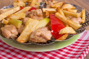 chicken with vegetables fried in oil