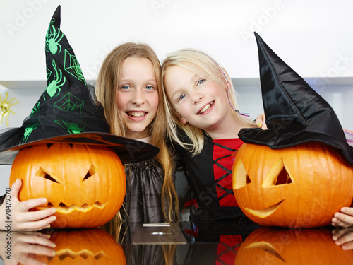 canvas print picture Cute girls with pumpkins in the kitchen