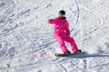 Snowboarder girl in pink in the Alps