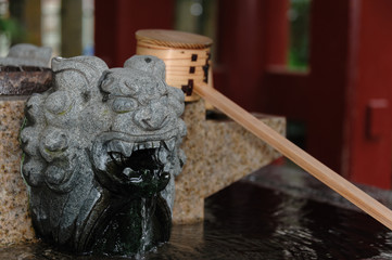 A small basin for ablution with lion figure in japanese temple