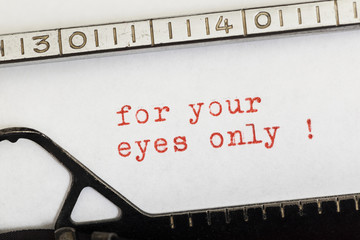 For your eyes only written in red on old typewriter
