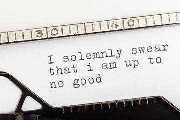 I am up to no good written on old typewriter