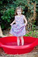 Funny girl in backyard pool