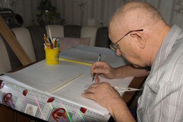 Man Drawing with Drafting Instruments