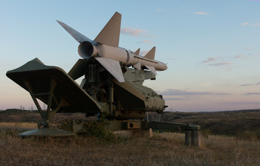Missile on a rocket launcher at dusk