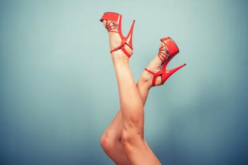 Female legs in stripper heels