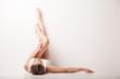 Leinwanddruck Bild - Beautiful woman legs raised up high lying