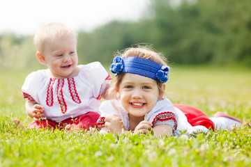 Happy children in russian folk clothes