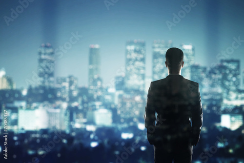 canvas print picture businessman looking to city