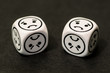 dice with sad emoticon sides