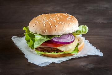 hamburger on a napkin on wooden table