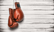 Boxing gloves hanging on wooden wall - 70485783