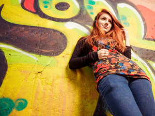 redhead woman at colorful wall