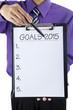 Businessman hand showing goals on 2015