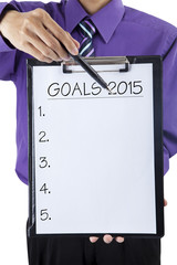 Businessman hand showing goals on 2015