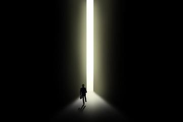 Businessman walking towards an open door