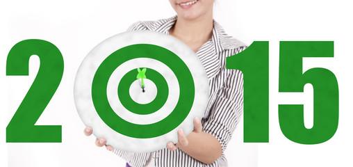 Businesswoman showing a green dartboard