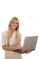 Smiling Blond Woman Holding Laptop in Studio