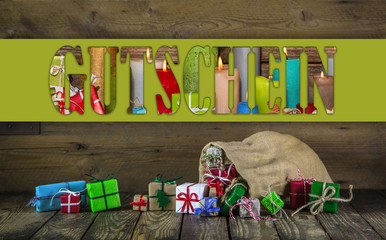 Many colorful christmas presents on wooden old background.