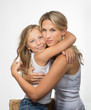 canvas print picture - Beautiful blonde mother and daughter embrance each other