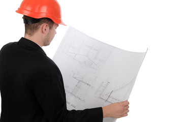 Young engineer consulting a building plan