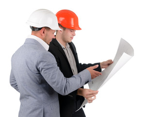 Two architects discussing a building plan