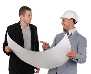 Architect discussing a blueprint with his partner