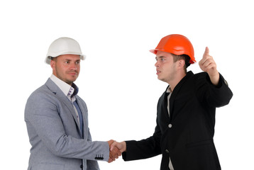 Architect welcoming a colleague and pointing
